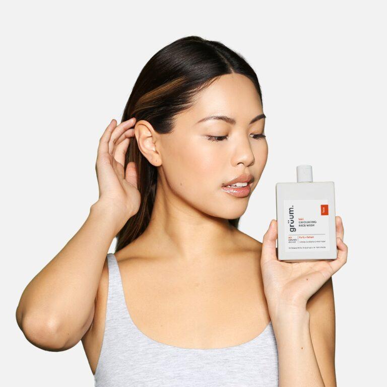 Photo of woman holding kori exfoliating face wash